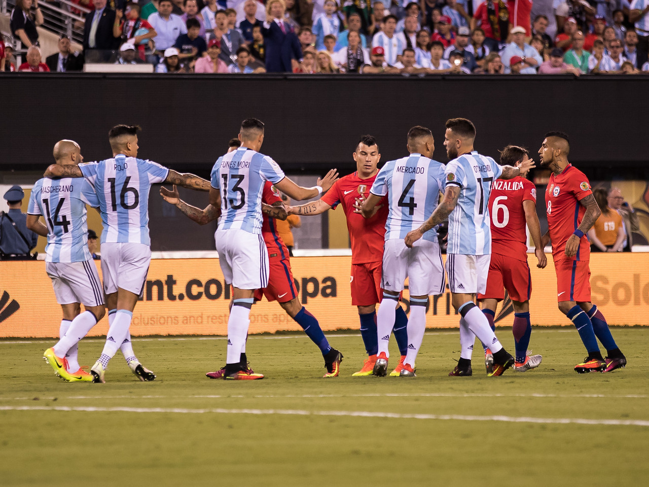 Argentina and Chile players discuss a play