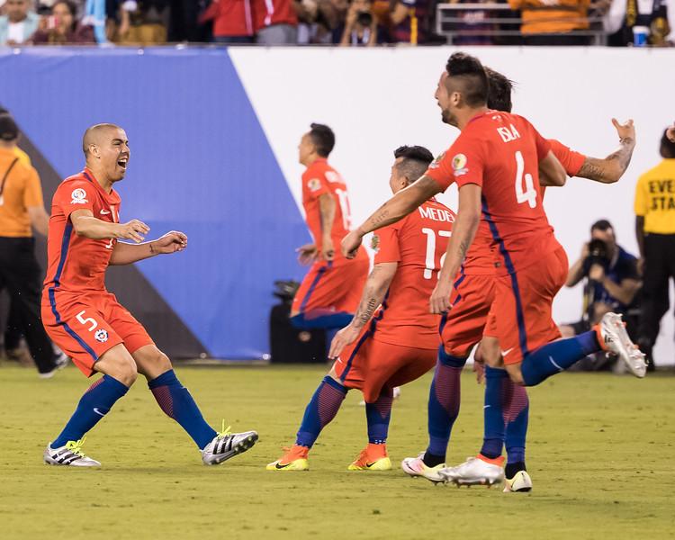 Chile players celebrate the winning penalty kick