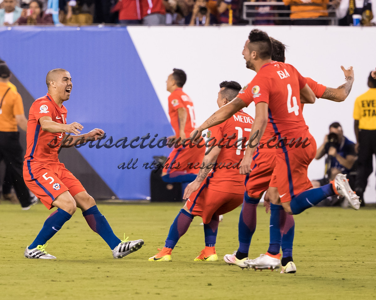 Chile players celebrate the winning penalty kick
