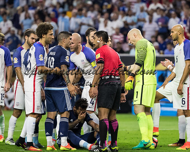 USA and Argentina players talk to the referee