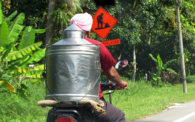 View from a car Window. Man on a Motorcycle