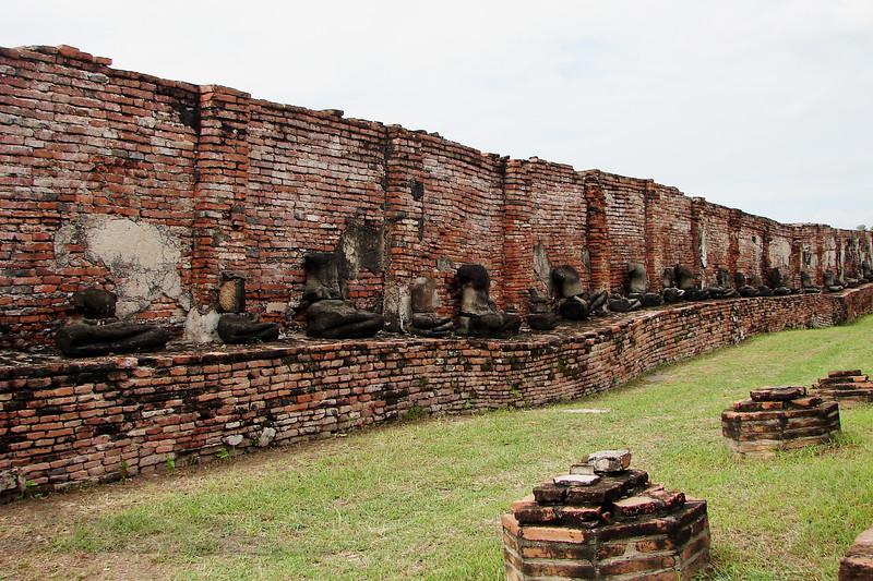 Wall with Remains of Buddha Statues - Ayutthaya - Thailand