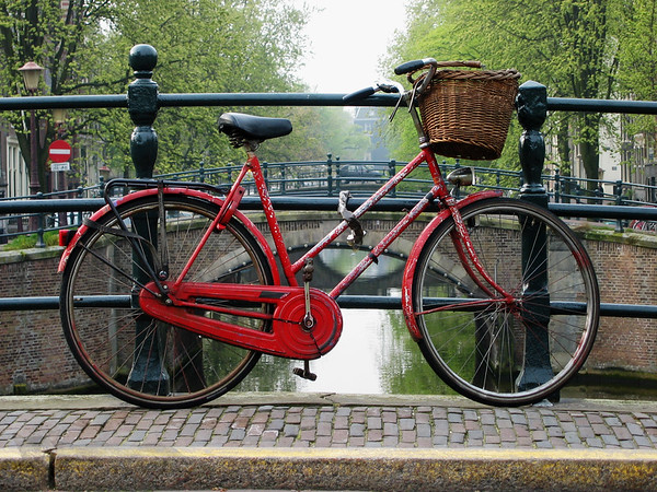 Red Bicycle on a Bridge