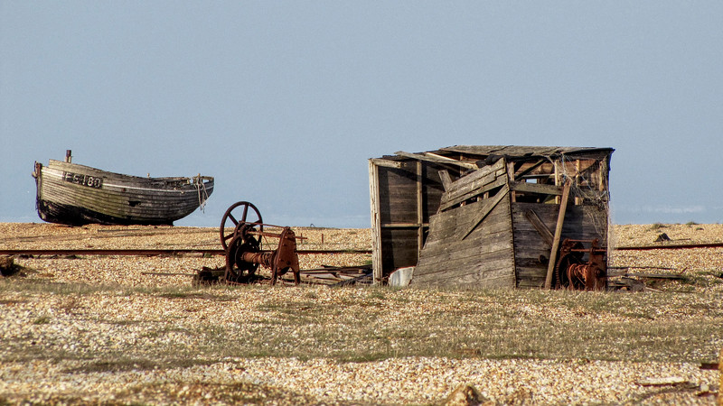 Dungeness Beach in Kent with huts and fishing boat
