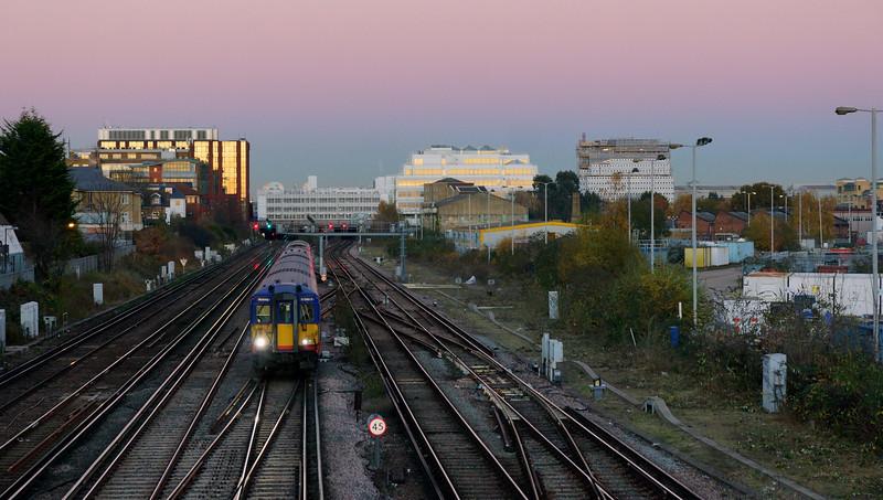 Alt Grove Footbridge - Train Leaving Wimbledon