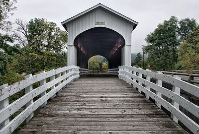 Currin Covered Bridge - Drive about 4 miles east of Cottage Grove on Row River Road. The bridge is on the right at the intersection with Laying Road.