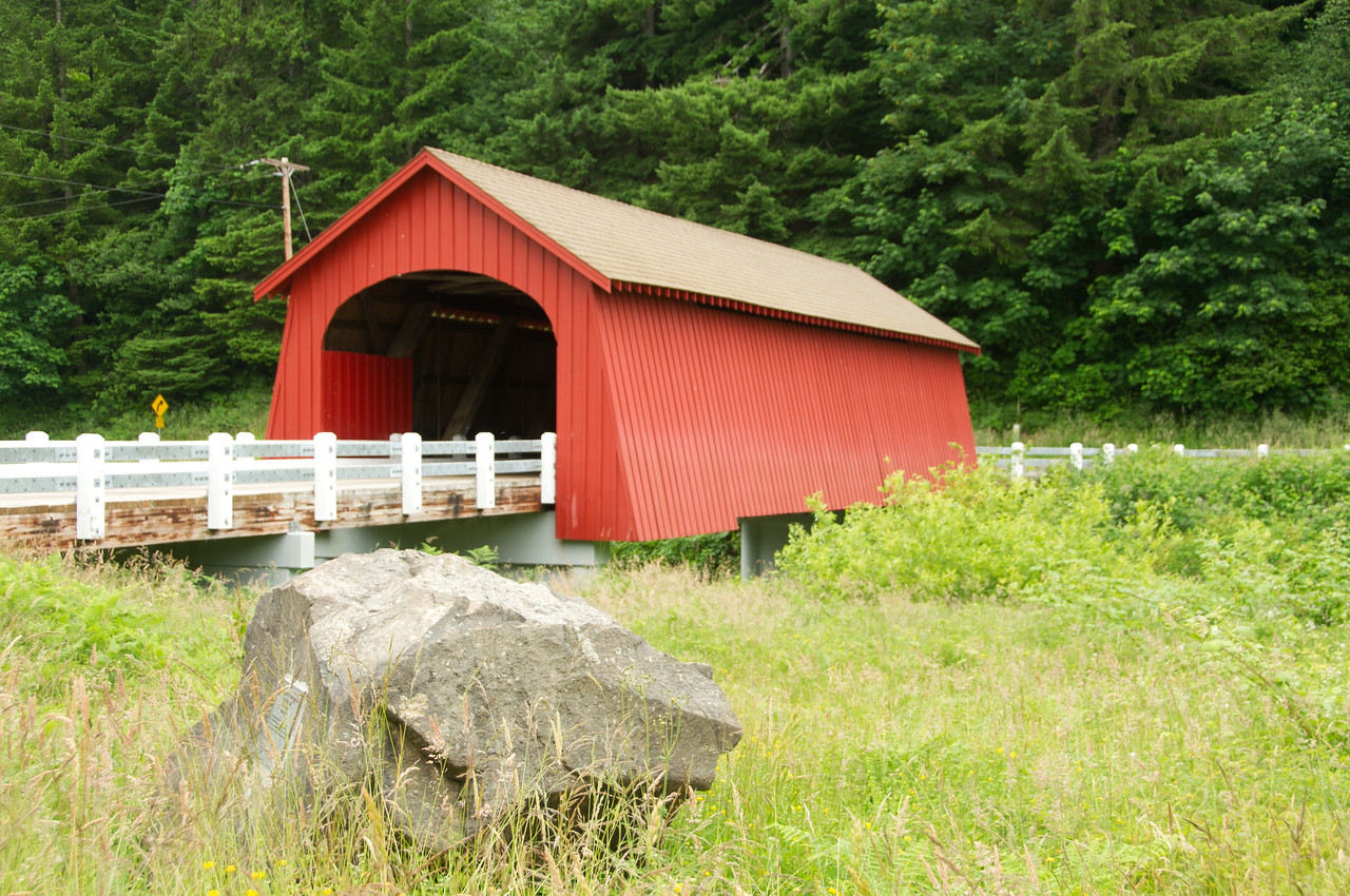 Fisher School Covered Bridge 1. Drive east on Hwy 34 from Waldport for about 20 miles. Turn south on 5 Rivers Road. Drive 9 miles on 5 Rivers Road to the bridge.
