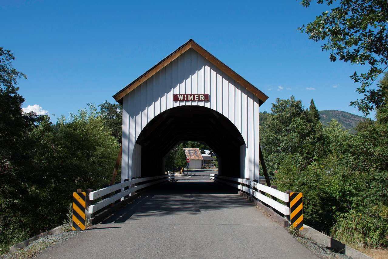 Wimer Covered Bridge. Take exit  Exit 48 off of I-5 at Rogue River, OR. Take Main Street to East Evans Creek Road. Drive about 8 miles north on East Evans Creek Road and follow the signs to Wimer Covered Bridge. There is a little country store at the bridge.
