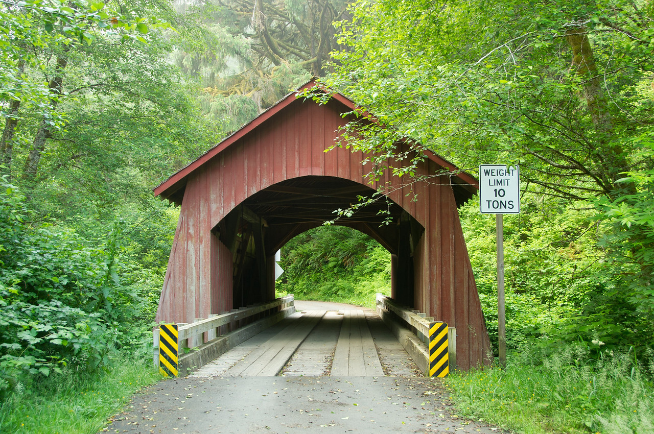 North Fork Yachats Covered Bridge 1. Take North Fork River Road off of Hwy 101 in Yachats. Drive 7 miles and turn left at the fork in the road. Drive about 1.5 miles on a gravel road to the bridge.