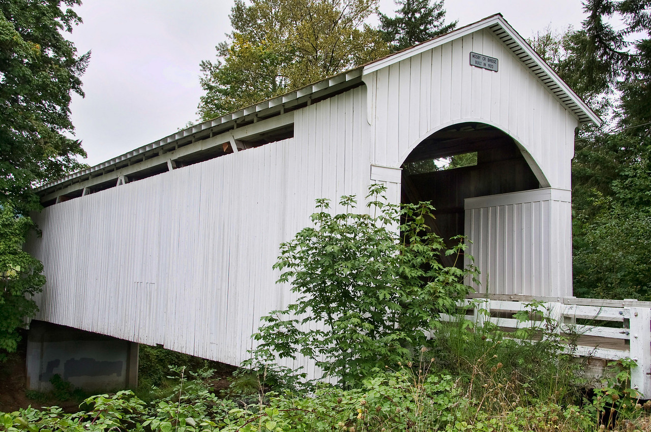 Mosby Creek Covered Bridge - Drive east of Cottage Grove about 4 miles along Row River Road. Turn right at Laying Road (Currin Covered bridge) and drive for about a quarter mile to the Mosby Creek Covered Bridge.