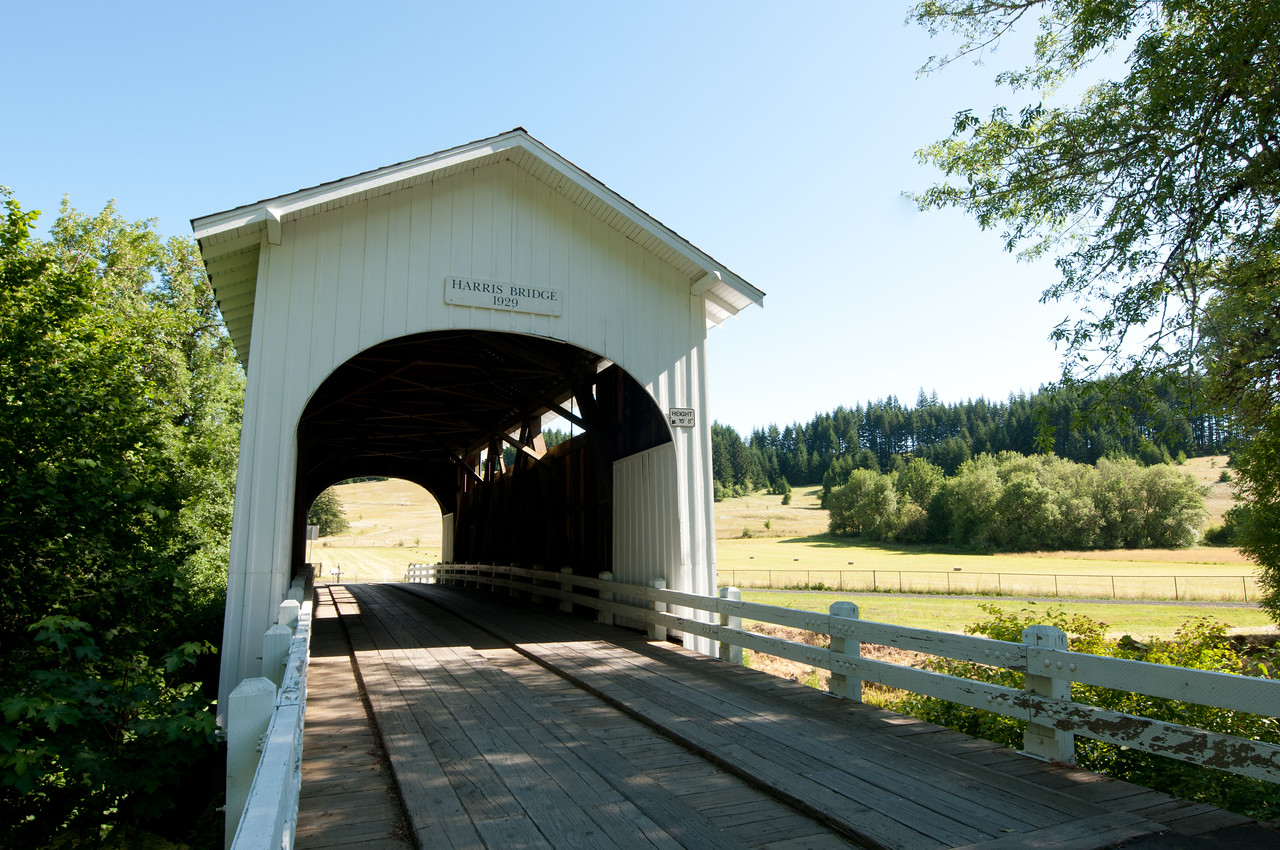 Harris Covered Bridge 1. Take Hwy 20 west from Corvallis. Take the Wren Exit and follow the sign to the Harris Vinyard and Covered Bridge. It is a couple of miles on a gravel road.