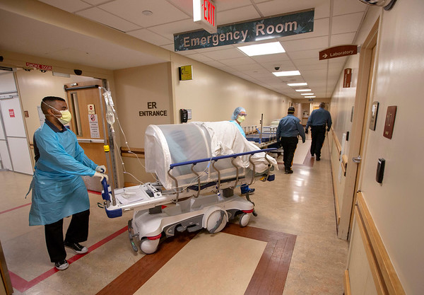 Transport of patient in Holy Name Medical Center in Teaneck, New Jersey, during the first few days of the COVID-19 Pandemic. 03/19/2020.  Photos by Jeff Rhode  Mandatory photo credit, and please use only with permission from Jeff Rhode and Holy Name Medical Center. <br /> If you need ID's or detailed captions please call 201-543-8067 or email jrhode@holyname.org