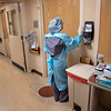 A nurse takes a moment, and a deep breath, before entering the room of a patient at Holy Name Medical Center in Teaneck, New Jersey, during the first few days of the COVID-19 Pandemic. 03/19/2020.  Photos by Jeff Rhode  Mandatory photo credit, and please use only with permission from Jeff Rhode and Holy Name Medical Center. <br /> If you need ID's or detailed captions please call 201-543-8067 or email jrhode@holyname.org
