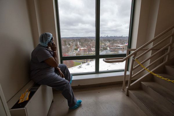 """Today I had to get from the 6th floor and was down to 2, the I.C.U. with just a few minutes between. I took the stairs and stumbled upon Brenda, a respiratory therapist, taking a much needed break staringat the NY skyline on a phone call. After a polite """"hello"""" she told me """"it's not a sunny day, but it is a great day"""" with a smile. The first patient since the craziness started 2 weeks ago had been extubated - a milestone. The breathing tube had been removed. She smiled, and told me how M&M's were her weakness. She seemed happy.Thinking about this is the first time I've actually broken down. Holy Name Medical Center in Teaneck, New Jersey, during the first weeks of the COVID-19 Pandemic.  03/25/2020  Photos by Jeff Rhode  Mandatory photo credit, and please use only with permission from Jeff Rhode and Holy Name Medical Center. <br /> If you need ID's or detailed captions please call 201-543-8067 or email jrhode@holyname.org"""