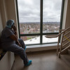 "Today I had to get from the 6th floor and was down to 2, the I.C.U.  with just a few minutes between. I took the stairs and stumbled upon Brenda, a respiratory therapist, taking a much needed break staring at the NY skyline on a phone call. After a polite ""hello"" she told me ""it's not a sunny day, but it is a great day"" with a smile. The first patient since the craziness started 2 weeks ago had been extubated - a milestone. The breathing tube had been removed. She smiled, and told me how M&M's were her weakness. She seemed happy. Thinking about this is the first time I've actually broken down.  Holy Name Medical Center in Teaneck, New Jersey, during the first weeks of the COVID-19 Pandemic.  03/25/2020  Photos by Jeff Rhode  Mandatory photo credit, and please use only with permission from Jeff Rhode and Holy Name Medical Center. <br /> If you need ID's or detailed captions please call 201-543-8067 or email jrhode@holyname.org"