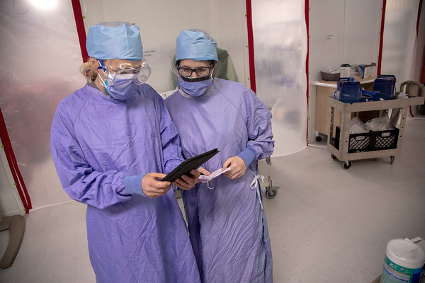 Lisa Blumer and Tracey Arnauer prepare an iPad for a patient to say good bye to family in the COVID ICU unit. <br /> Holy Name Medical Center in Teaneck, New Jersey, during the first weeks of the COVID-19 Pandemic.  04/07/2020  Photos by Jeff Rhode  Mandatory photo credit, and please use only with permission from Jeff Rhode and Holy Name Medical Center. <br /> If you need ID's or detailed captions please call 201-543-8067 or email jrhode@holyname.org