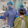 Physical Therapist Jules O'Hagan and Lisa McConville of Holy Name Medical Center remove and isopod from a patient for physical therapy. Following extubation the patients can be very weak and stiff, and need physical therapy. Photos at Holy Name Medical Center during the first weeks of the COVID-19 Pandemic.  <br /> 04/14/2020  Photos by Jeff Rhode/Holy Name Medical Center.  Mandatory photo credit, and please use only with permission from Jeff Rhode and Holy Name Medical Center. <br /> If you need ID's or detailed captions please call 201-543-8067 or email jrhode@holyname.org