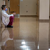 A healthcare provider takes a break in the hallway at Holy Name Medical Center during the first weeks of the COVID-19 Pandemic. <br /> <br /> 04/15/2020  Photos by Jeff Rhode/Holy Name Medical Center.  Mandatory photo credit, and please use only with permission from Jeff Rhode and Holy Name Medical Center. <br /> If you need ID's or detailed captions please call 201-543-8067 or email jrhode@holyname.org
