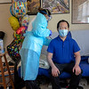 Home Care nurse Veronica Victorero visits Christopher Yeun in his home for a check up following his discharge from Holy Name Medical Center for COVID-19. Home care nurses must don PPE before going inside, typically at the car, and doff immediately after leaving the home outside or in the hallway. <br />  <br /> 05/15/2020  Photos by Jeff Rhode/Holy Name Medical Center.  Mandatory photo credit, and please use only with permission from Jeff Rhode and Holy Name Medical Center. <br /> If you need ID's or detailed captions please call 201-543-8067 or email jrhode@holyname.org