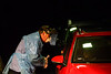 Jerry Roberge, a paramedic at Brattleboro Memorial Hospital, in Brattleboro, Vt., gives instructions to people in a car about how to administer the COVID-19 test during a drive-thru style testing site on Wednesday, Dec. 3, 2020. BMH has tested around 550 people for the virus using the drive-thru style since November 18, 2020.