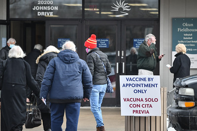 Johnson County residents move in and out of Okun Fieldhouse in Shawnee on Jan. 27 to received their COVID-19 vaccinations.