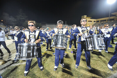 The Cal Poly Mustang Marching Band and UC Davis Band-Uh! perform during the 2014  Battle of the Bands. Nov. 15, 2014. Photo by Ian Billings
