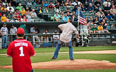 Representing the Chicago Police Department, Superintendent Garry McCarthy, throws a ceremonial pitch prior to the Chicago Fire vs Chicago Police Charity Baseball Game at US Cellular Field, Home of the Chicago White Sox professional baseball team, Chicago, Illinois