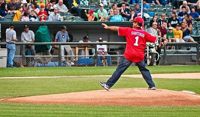 Representing the Chicago Fire Department, Fire Commissioner, Jose A. Santiago throws a ceremonial pitch prior to the Chicago Fire vs Chicago Police Charity Baseball Game at US Cellular Field, home of the Chicago White Sox Professional Baseball Team, Chicago, Illinois