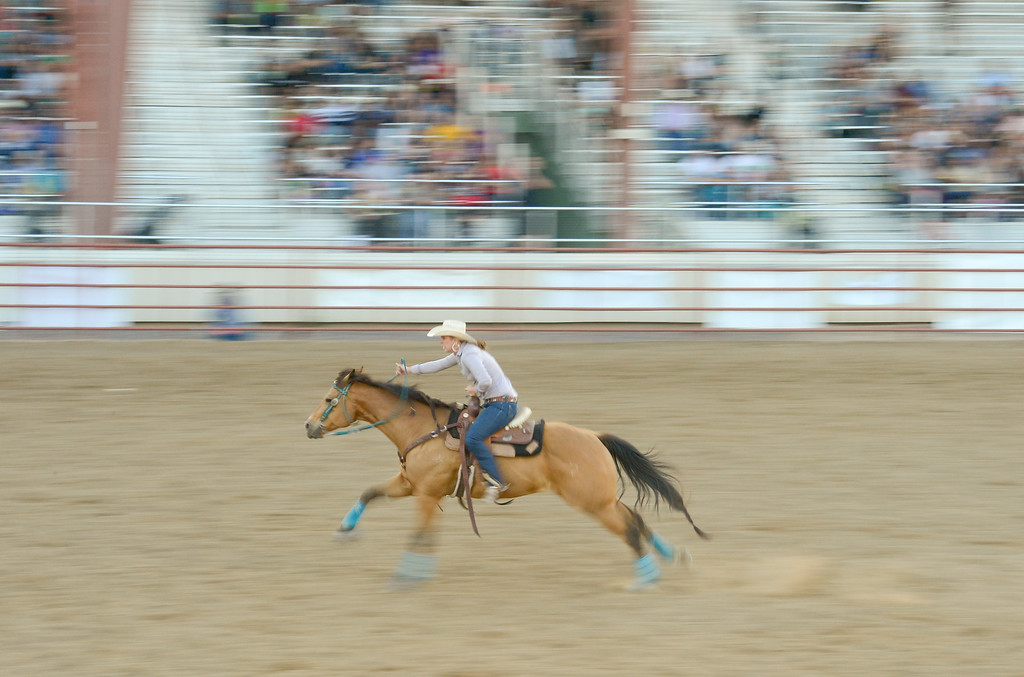 . LONGMONT, CO - AUGUST 5: Barrel Racer Tori Cooper, of Brighton, races toward the finish during the CPRA rodeo at the Boulder County Fair on Aug. 5, 2018.  (Photo by Matthew Jonas/Staff Photographer)