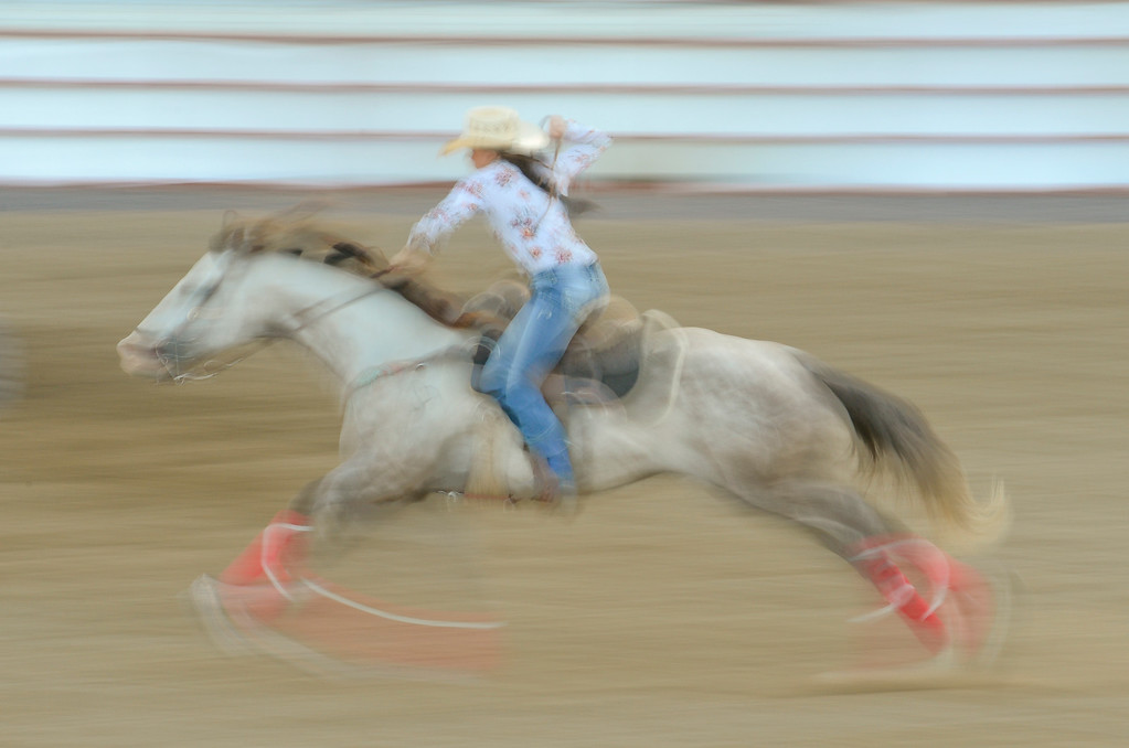 . LONGMONT, CO - AUGUST 5: Barrel Racer Kelsey Haas McNamee, of Kersey, races toward the finish during the CPRA rodeo at the Boulder County Fair on Aug. 5, 2018.  (Photo by Matthew Jonas/Staff Photographer)