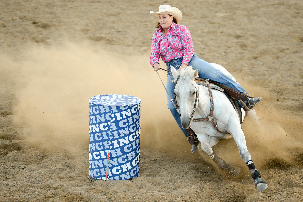 . LONGMONT, CO - AUGUST 5: Barrel Racer Melanie Luark, of Kersey, turns around a barrel during the CPRA rodeo at the Boulder County Fair on Aug. 5, 2018.  (Photo by Matthew Jonas/Staff Photographer)
