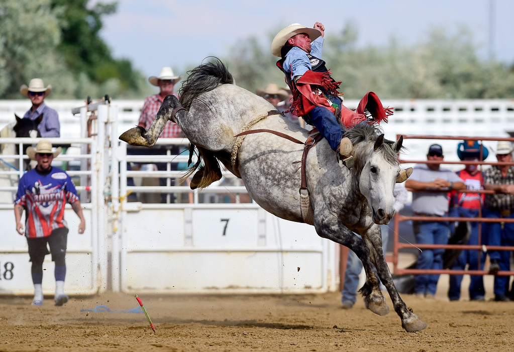. LONGMONT, CO - AUGUST 5: Bareback rider David Streweler, of Brighton, hangs on for eight seconds during the CPRA rodeo at the Boulder County Fair on Aug. 5, 2018.  (Photo by Matthew Jonas/Staff Photographer)