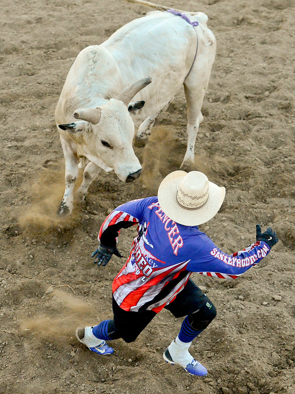 . LONGMONT, CO - AUGUST 5: Bullfighter Jake Spencer distracts a bull during the CPRA rodeo at the Boulder County Fair on Aug. 5, 2018.  (Photo by Matthew Jonas/Staff Photographer)
