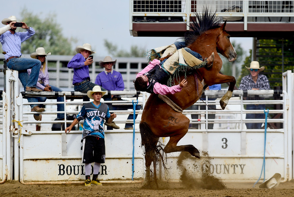 . LONGMONT, CO - AUGUST 5: Bareback Rider Austin Reynolds, of Loveland, tries to hang on during the CPRA rodeo at the Boulder County Fair on Aug. 5, 2018.  (Photo by Matthew Jonas/Staff Photographer)