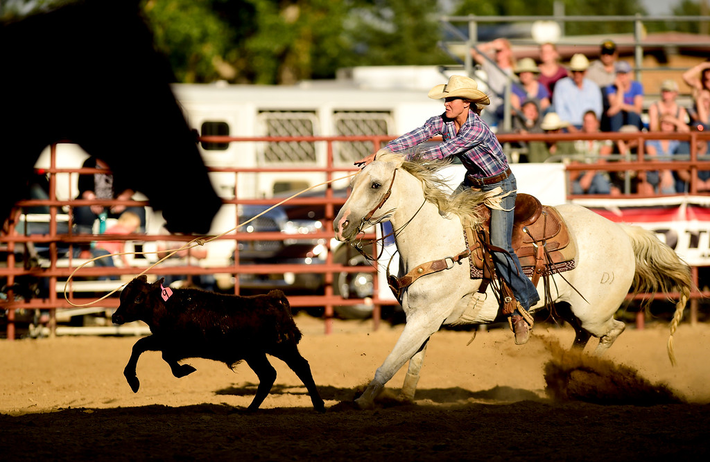 . LONGMONT, CO - AUGUST 5: Dani Buhler, of Fort Collins, tries to rope a calf during the CPRA rodeo at the Boulder County Fair on Aug. 5, 2018.  (Photo by Matthew Jonas/Staff Photographer)