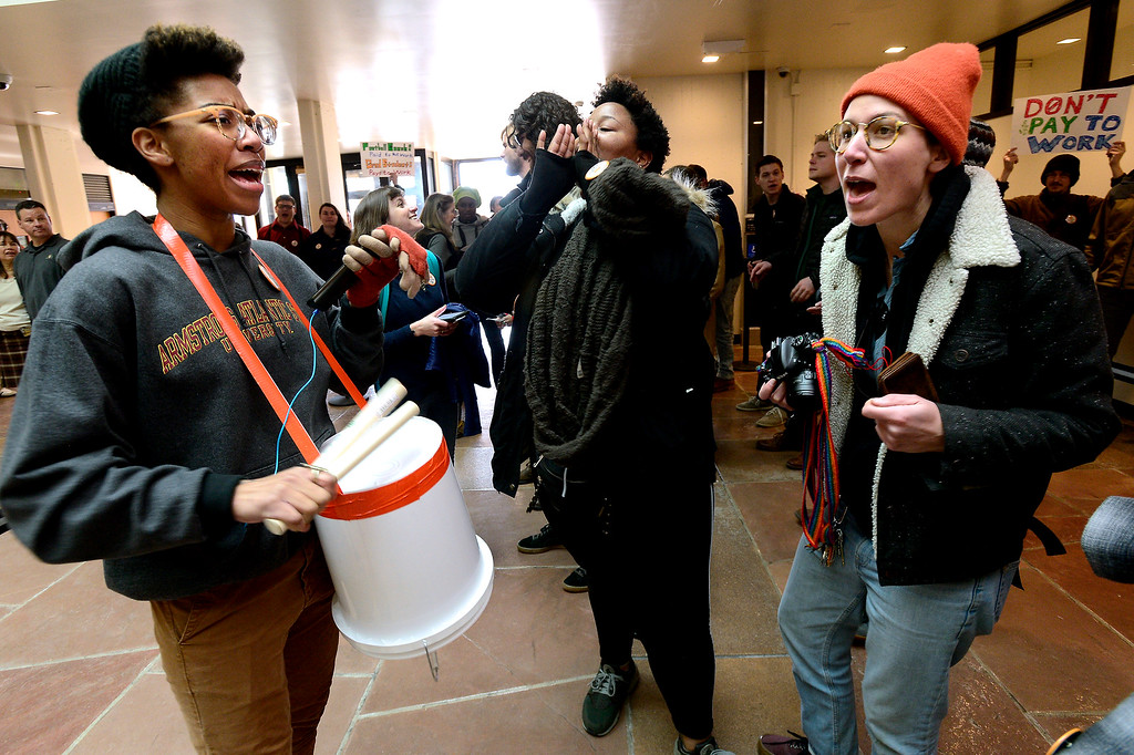 . Natalie, who declined to give her last name, at left, Simone Hyater-Adams and Arielle Milkman, cheer slogans and bang on drums on the first floor of the Regent Administrative Center during a protest against student fees on graduate students led by the Committee on Rights and Compensation (CRC) University of Colorado\'s Graduate Labor Union on Tuesday February 5, 2019.  For more photos and video go to dailycamera.com (Photo by Paul Aiken/Staff Photographer)