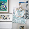 Textile designed handbags with framed artwork in Birmingham work studio, England, UK