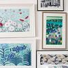 Collection of framed artwork in Birmingham work studio, England, UK