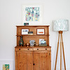 Wooden sideboard and lamp in Birmingham home, England, UK