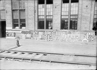 2018.18.GP.023--philip weibler collection 5x7 glass plate neg--CRI&P--tool rack outside company shops--Silvis IL--no date