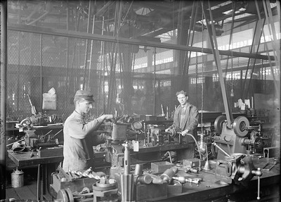 2018.18.GP.007--weibler collection 5x7 glass plate--CRI&P--employees repairing air tools in tool room at company shops--Silvis IL--no date
