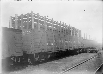 2018.18.GP.026--philip weibler collection 5x7 glass plate neg--CRI&P--C&NW gondola loaded with loose scrap iron at company shops--Silvis IL--no date