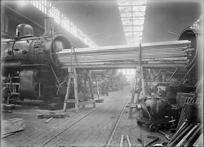 2018.18.GP.014--weibler collection 5x7 glass plate--CRI&P--flues being removed from steam locomotive at company shops--Silvis IL--no date
