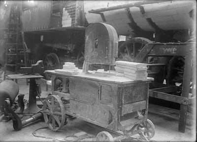 2018.18.GP.021--weibler collection 5x7 glass plate--CRI&P--asbestos band saw cutting batts of lagging to fit firebox in background--Silvis IL--no date