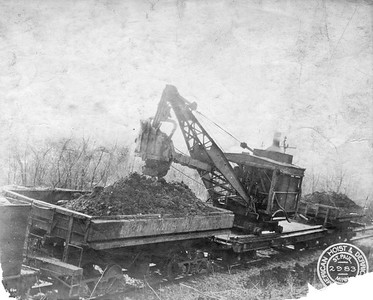 2020.016.W.011--phil weibler collection 8x10 photostat--CRI&P--steam crane on flatcar loading side dump--location unknown--no date