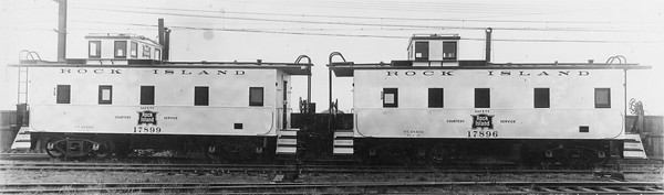2020.016.C.009--phil weibler collection 8x10 print--CRI&P--new steel caboose 17899 17896--Chicago IL--1930 0500. Built at Rock Island 124th Street shops, Blue Island, IL. Exterior painted aluminum to reduce interior temperature up to ten degrees in summer.