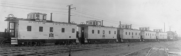 2020.016.C.011--phil weibler collection 8x10 print--CRI&P--new steel caboose 17895 and others scene--Chicago IL--1930 0500. Built at Rock Island 124th Street shops, Blue Island, IL. Exterior painted aluminum to reduce interior temperature up to ten degrees in summer.