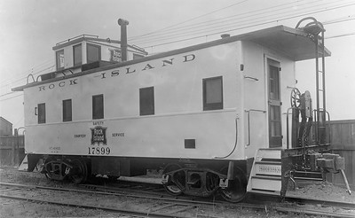 2020.016.C.010--phil weibler collection 8x10 print--CRI&P--new steel caboose 17899--Chicago IL--1930 0500. Built at Rock Island 124th Street shops, Blue Island, IL. Exterior painted aluminum to reduce interior temperature up to ten degrees in summer.
