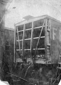 2020.016.OF.002--phil weibler collection 8x10 print--SLSF--wooden boxcar end damage from shifted load at 47th Street--Chiacgo IL--1915 0305