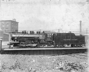 2020.016.S.002--phil weibler collection 8x10 print--B&O--ALCO steam locomotive 0-6-0 386 on turntable--location unknown--no date